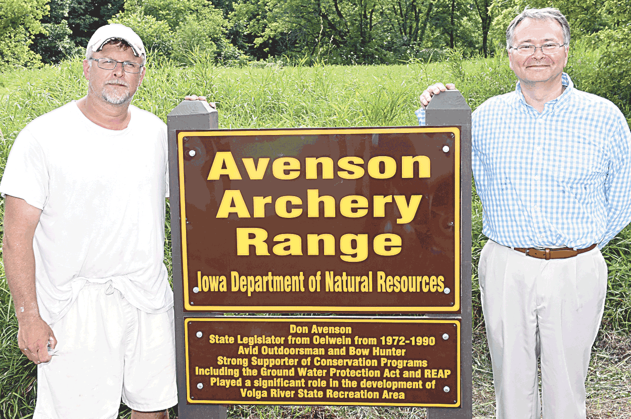 p.p1 {margin: 0.0px 0.0px 0.0px 0.0px; text-align: justify; line-height: 9.0px; font: 9.0px 'Helvetica Neue'}				(Don Avenson's two sons, Clay (left) and Eric, proudly stand beside the sign proclaiming that the archery range at Volga River Recreation Area will henceforth be known...