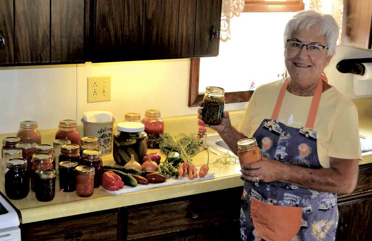 Karen Dyke started canning many years ago, and it quickly became one of her favorite pastimes. One of the most rewarding aspects of her hobby is watching granddaughters Ashley and Erica begin to take an interest in canning as well. (Erica Dyke photo) 	Preserving goodness through...