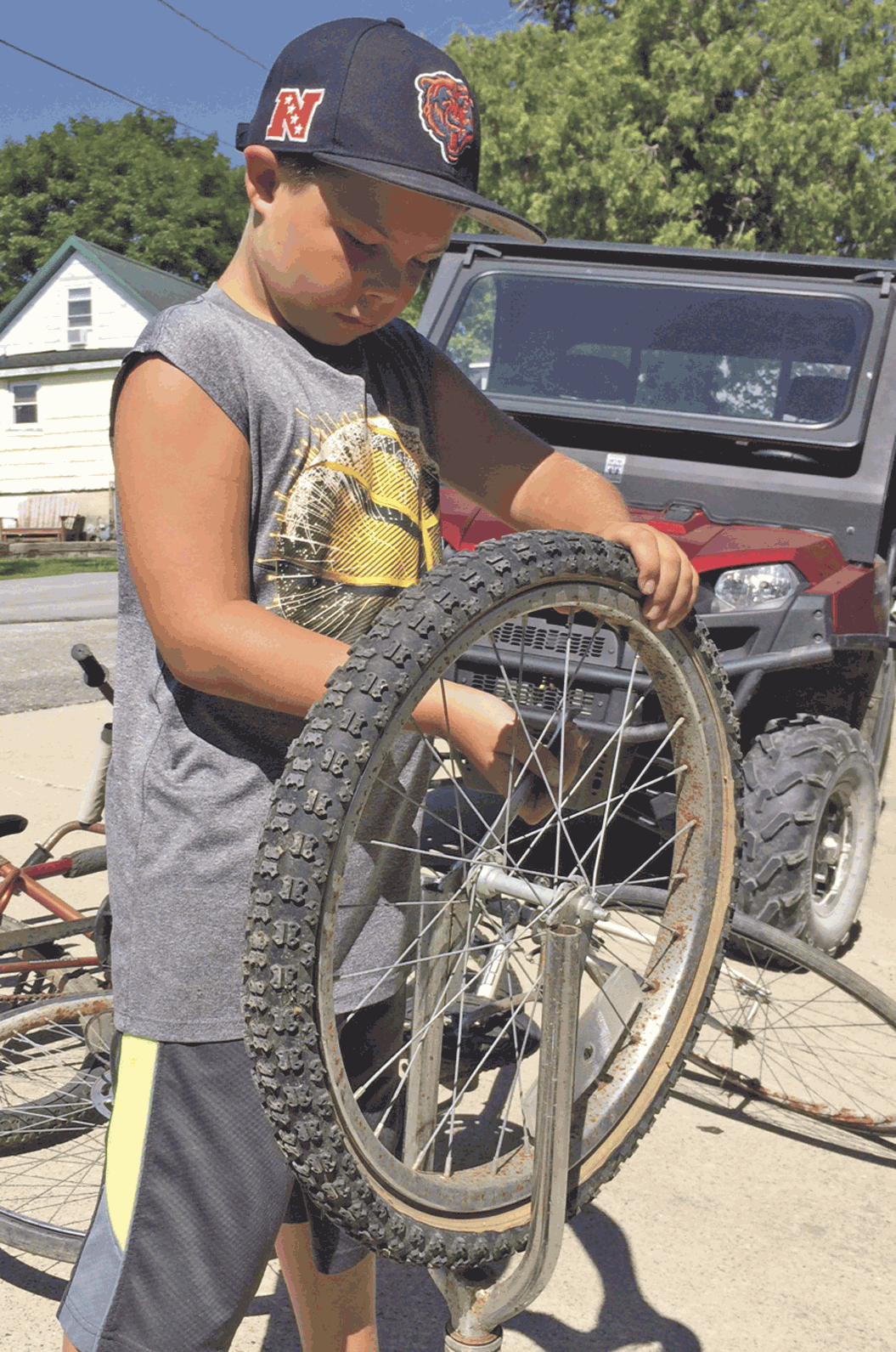 p.p1 {margin: 0.0px 0.0px 10.0px 0.0px; font: 12.0px Cambria}span.s1 {font: 10.0px Cambria}	Jackson Goltz of Ossian helps prepare for RAGBRAI, which will be rolling through town Friday morning. A full slate of fun and activities are planned for the big day, including food, music, and...