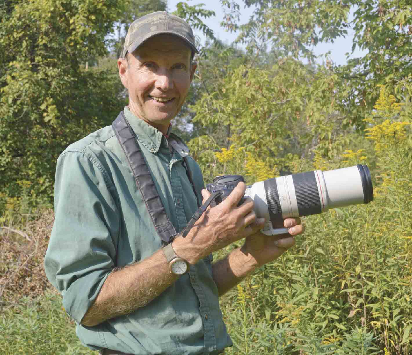 Larry Reis of Calmar was recently presented with the Outstanding Partner Award by Northeast Iowa Resource Conservation and Development for his dedication to natural resource interpretation, education, and photography. (Zakary Kriener photo) 	Reis receives Outstanding Partner...