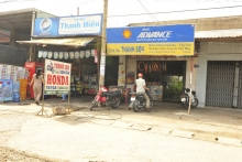 """CUTLINE: These """"stores"""" in Vietnam may seem unduly small and dirty, but they line Highway 1 from Saigon to Xuan Loc, 30 miles of little shops. They normally supply one kind of item and provide a living to the entrepreneurs running them. (Jerry Wadian photo)"""